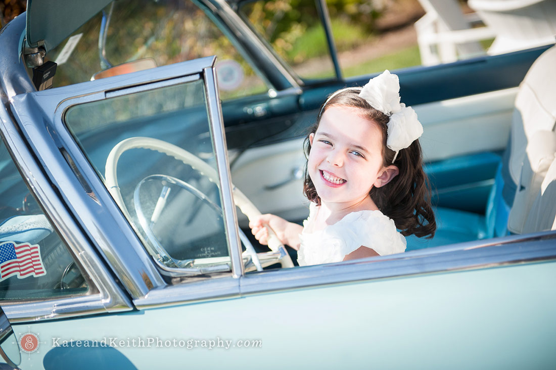 Girl driving car at wedding