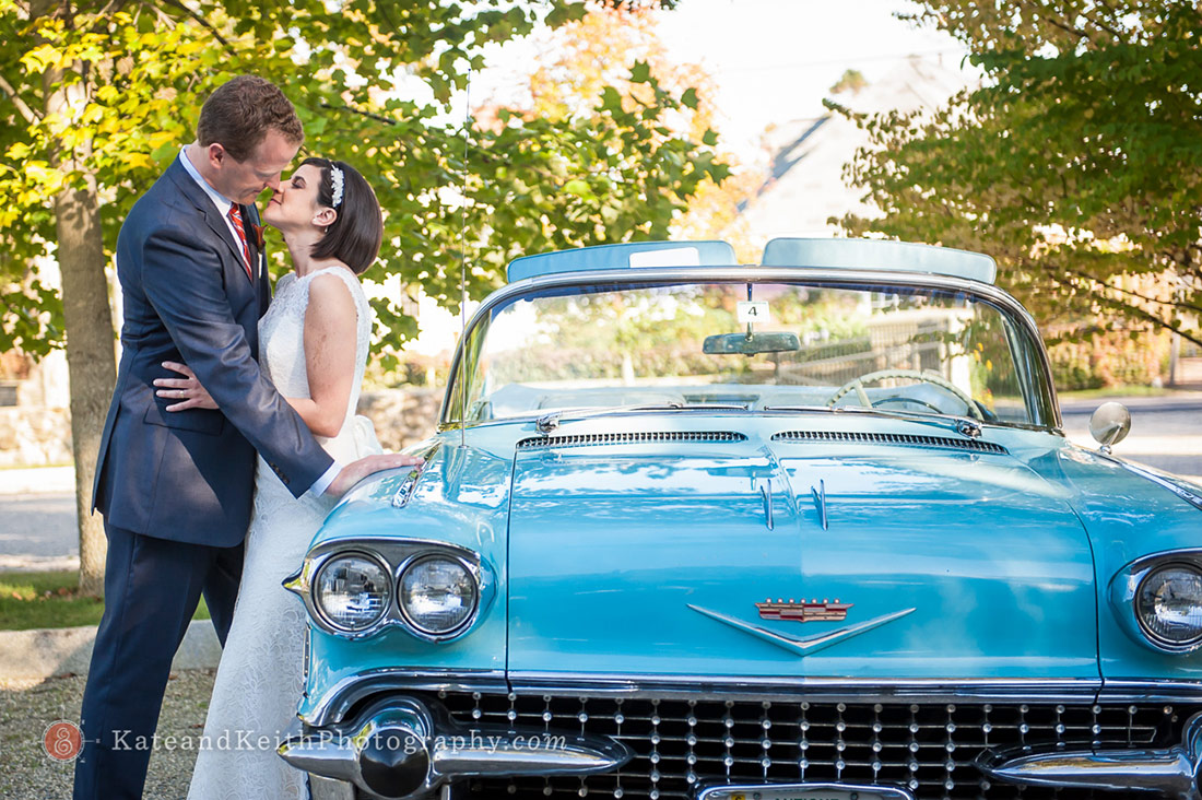 Bride and groom with antique car at Fuller Gardens wedding North Hampton NH