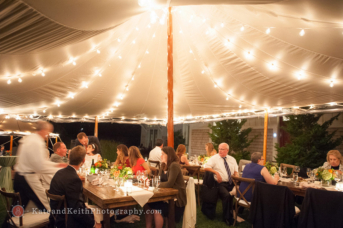 Dinner under lighted tent wedding
