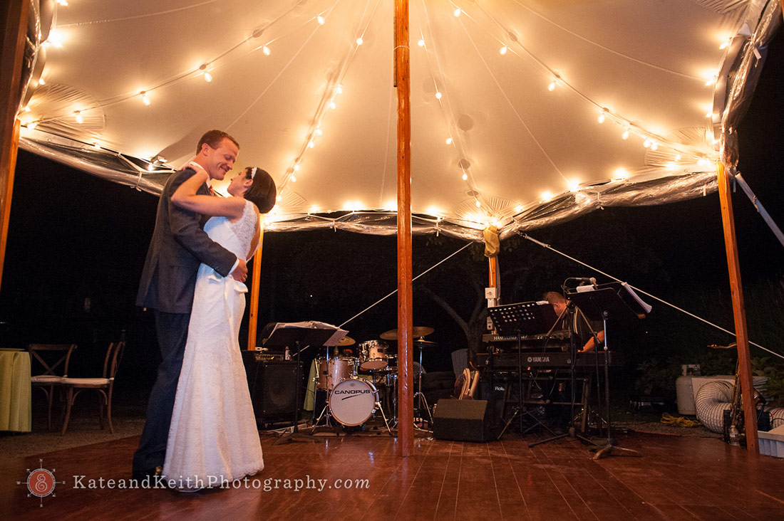 Dancing under lighted tent wedding