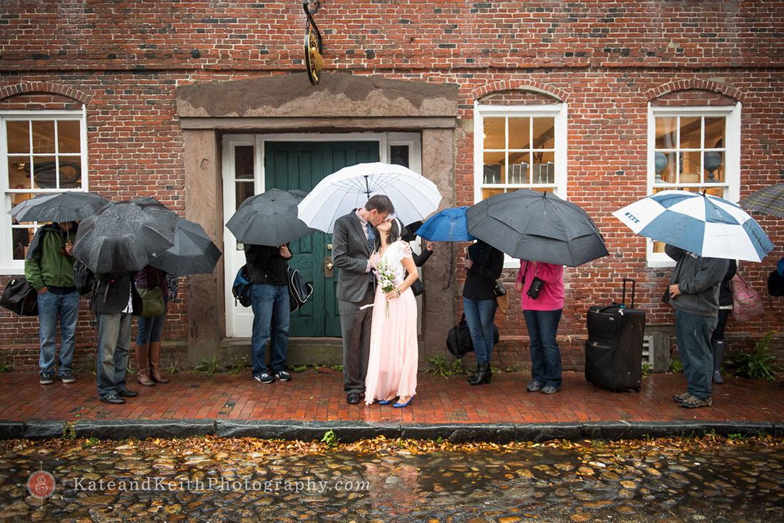 downtown Nantucket Wedding photos bride and groom under umbrella