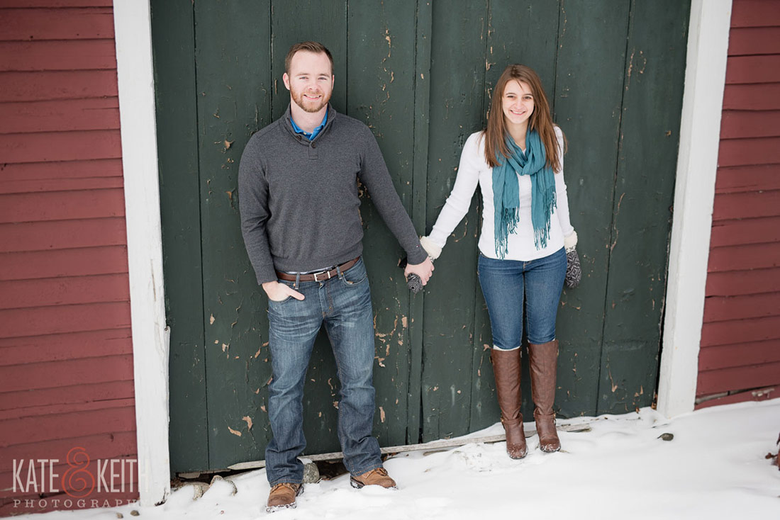 Couple in front of barn doors