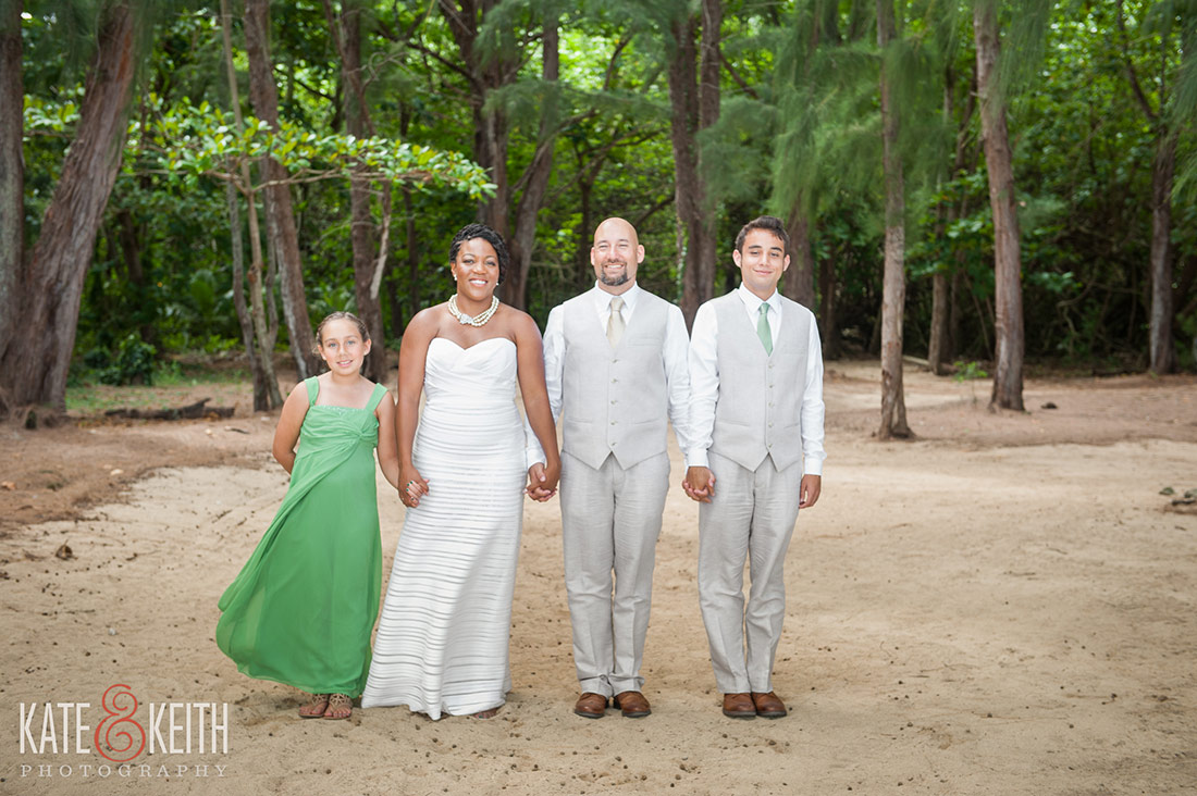 Hawaiian beach wedding at Kualoa Ranch's Secret Island in Oahu by destination photographers