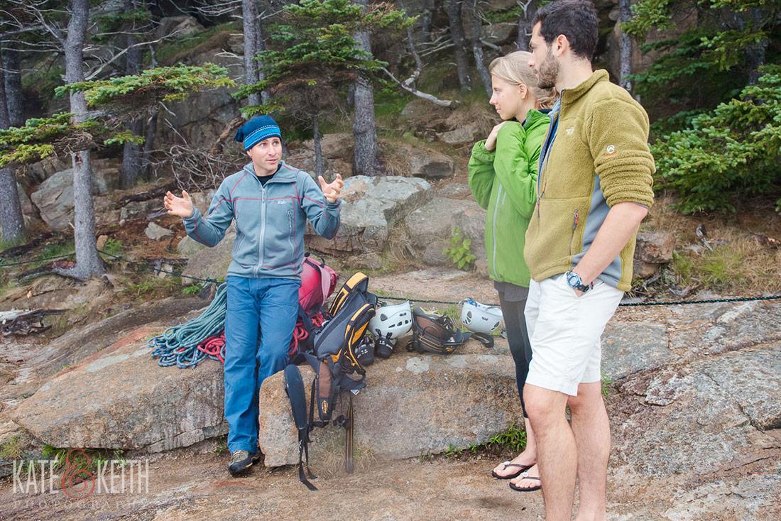 couple rock climbing Acadia engagement photos