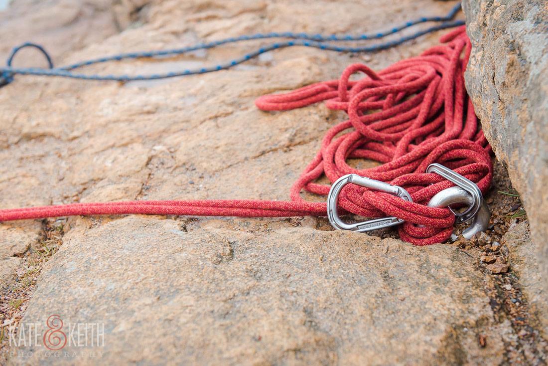 Acadia couple rock climbing post wedding at Otter Cliffs!