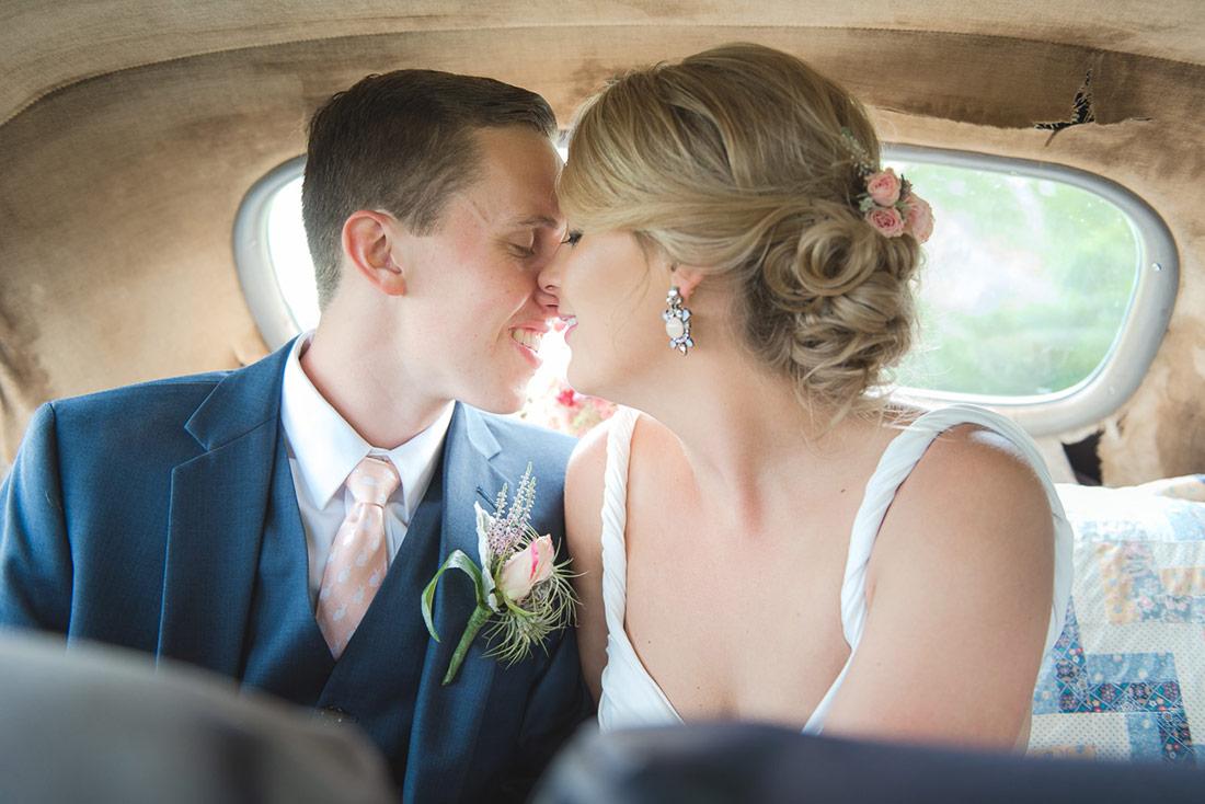 bride and groom in antique car