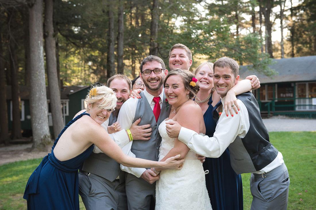 camp wedding group hug