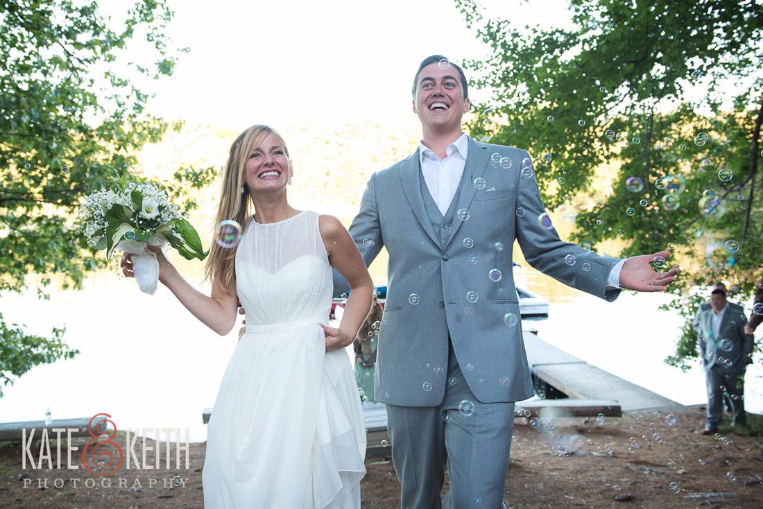 bride and groom with bubbles Camp Waziyatah Wedding