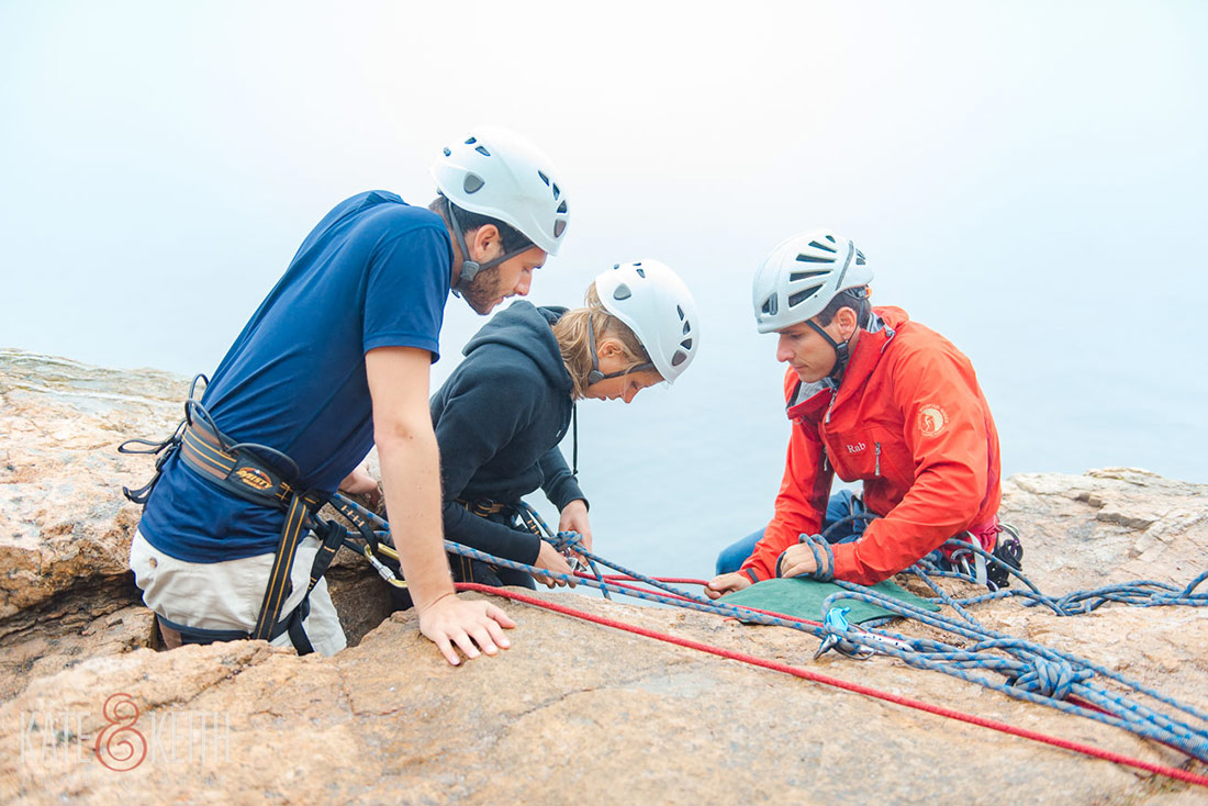 Acadia couple rock climbing post wedding at Otter Cliffs!