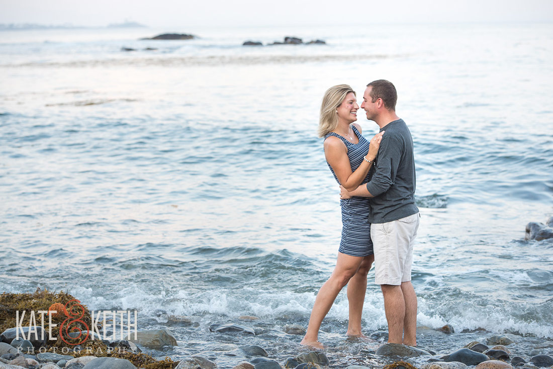 couple engagement in water on coast