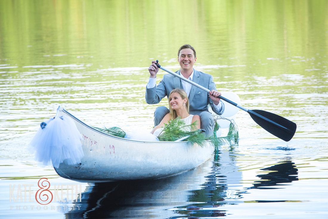 bride and groom in canoe Camp Waziyatah Wedding